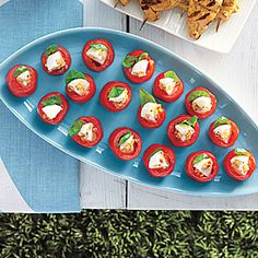 For an easy, no-cook side dish, serve Mozzarella-Stuffed Cherry Tomatoes. These stuffed cherry tomatoes are a tasty complement to summertime grilling. Vegetarian Appetizers, Appetizer Recipes, Snack Recipes, Appetizer Ideas, Party Recipes, Party Snacks, Cherry Tomato Recipes, Sandwiches, Recipes