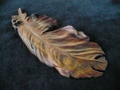 Hand carved walnut feather by DesertRavenArt on Etsy, $150.00