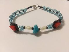 Handmade Beaded Bracelet Featuring a Center Turquoise Stone with Genuine Pearl and Red Coral Accents. Coral Accents, Glass Gemstone, Red Coral, Turquoise Stone, Beadwork, My Etsy Shop, Beaded Bracelets, Gemstones, Pearls