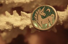 Vintage 1960s turquoise and Mother of Pearl Inlay Unicorn Pendant. $17.00, via Etsy.