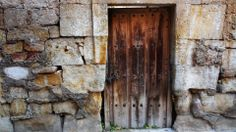 Stone wall, Salamanca Spain.  Traditional construction. Timber Door. weathered. historic.