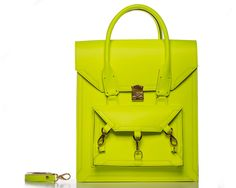 Neon Yellow Pelham tote bag can be worn across the body as a cross body bag with a detachable shoulders straps. The structured smooth sturdy cow leather comes with all gold-tone hardware the main front clutch lock its a Swiss-made lock, and with three trigger hooks and D ring hardware. The handle of the bag it's a rolled skinny handle with chunky stitches on both sides of the handle and leather pattern trimmings. #bag #handbag #tote #neonyellow