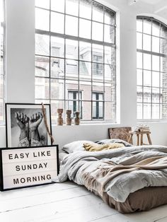 "A gorgeous and cozy neutral bedroom with ""Easy Like Sunday Morning"" sign and…"
