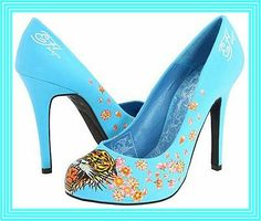 Ed Hardy Haute Sky Blue Tiger Pumps. These big cat style trending women's shoes have stiletto heels, rounded vamp and toe, with a roaring tiger on the toes and pink flowers on the sides.