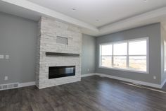 Electric fireplace with chocolate poplar floating mantle surrounded by Coronado - Pro Ledge - White stone