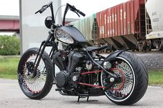 """BMS, the Kings of Detail, stay true to their rep and the Bolt's bobber heritage: ol' school springer front end & seat, ridged rear, chain drive, classic peanut tank, roll'n on thick spoke 23"""" front & 18"""" rear wheels..."""