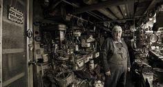 Photographer: Craig Wetjen. From his series/book men and their sheds.I find these portraits really interesting, these images really show how passionate people are with their sheds and things they treasure. The black and white/ sepia like tones works beautifully in this photograph.