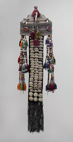 """""""Central Asia or Iran   Crown; Silver, with decorative wire and stamped decoration, table-cut incised carnelians, turquoise, beads, openwork, and silver coins; quilted cotton lining, cotton cords and tassels with beads, and velvet strip with metal ornaments   20th century"""" Metropolitan Museum in New York BUT the Wolf collection and the book have been severely criticised by several connoisseurs ~ http://www.facebook.com/photo.php?fbid=10150376394673049=a.365927863048.151707.365830083048=3"""