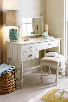 Pier 1's Cottage Bedroom Collection has all the charm of a summer home in New England, where painted wood furniture has long been the tradition. With its soft white, gently distressed finish, each piece features elements of the cozy, rustic style, including simple, honest lines, beadboard-inspired accents, crown molding, scalloped aprons, knob pulls and Sheraton legs. Our vanity comes with a tilting mirror and three drawers for ample storage.