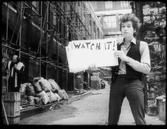 A still from Don't Look Back, a documentary directed and produced by DA Pennebaker shows Bob Dylan performing the song Subterranean Homesick Blues...