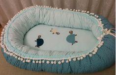 Ponponlu bebek yuvası