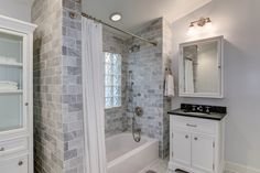 """Cottage Full Bathroom with Brockport 2 Light Vanity Light by Dolan Designs, Glass Block 8"""" x 8"""" Icescapes Block by Daltile"""