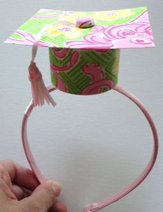 We can make mickey ear headbands with tiny graduation caps like this out of felt @Cindy Johnson