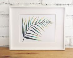 This is a giclee print of an original watercolor of a palm leaf. The beautiful shades of green and yellow blend into each other in an organic