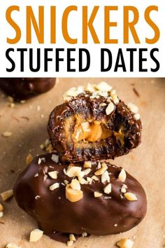 Medjool dates stuffed with peanut butter and peanuts and coated in chocolate. These chocolate covered snickers stuffed dates are made with real food ingredients and taste even better than an actual Snickers bar. #snickers #dates #stuffeddates #candy #chocolate #healthy #peanutbutter #peanuts #eatingbirdfood