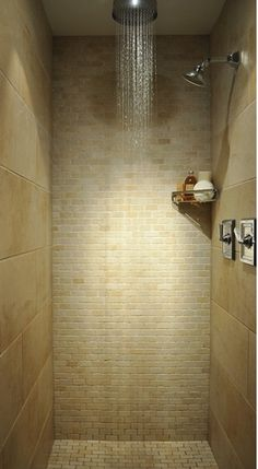 small but clean and organized shower with floating shower shelf, rain shower head, beige wall tile and mosaics... 5 Steps to Make Your Small Shower Look Bigger Without Remodeling from Bathroom Bliss by Rotator Rod