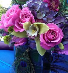 colorful centerpiece with peacock feathers