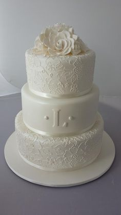 3 teir wedding cake with free hand piping ~  		~ the piping matches the brides  wedding dress embroidery.