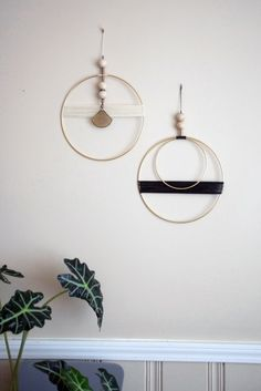 Beautiful brass and waxed cord wall hanging with raw wood and vintage brass bead detail. Measurements: - Larger brass circle is - Smaller brass circle is - Beaded hanger above circles is - T Diy Wand, Mason Jar Crafts, Mason Jar Diy, Diy Home Decor Projects, Diy Projects To Try, Decor Ideas, Decorating Ideas, Mobiles, Diy Wall Art