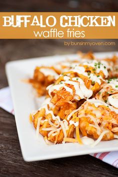 Buffalo Chicken Waffle Fries #recipe by bunsinmyoven.com | Forget ketchup! These fries are topped with spicy buffalo chicken and ranch!