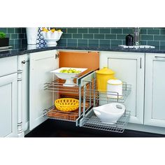 Rev-A-Shelf W x H Pull Out Metal Cabinet Organizer at Lowe's. Rev-A-Shelf's series maximizes space in blind corner cabinets while allowing the user full accessibility to the entire unit. The unit is easy to Kitchen Drawer Organization, Basket Organization, Kitchen Storage, Food Storage, Kitchen Pantry, Diy Kitchen, Kitchen Gadgets, Kitchen Decor, Organization Hacks