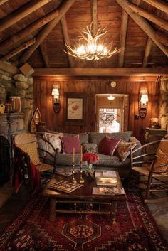 Adirondack/ Americana Style - Here we see natural elements from the antler chandelier to the rustic coffee table. This landscape uses many organic adornments to create a cabin-like flow to the space.