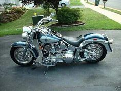 Harley Davidson. The darker blue would be so pretty all over the bike.