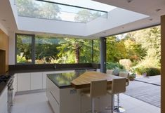 love the modern design; skylight; all the glass and how it joins to the garden