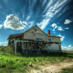 Abandoned home in Saskatchewan.  I love the contrast of the decay and ruin against such a beautiful, vibrant sky.