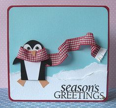 the penguin is hand cut using assorted colors of paper and pieced together - LOVE the scarf!!