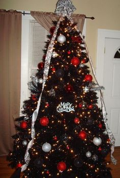red and silver ornaments on the tuxedo black christmas tree this but 10x more