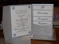DIY pocket invites -- snowflake themed for a winter wedding.