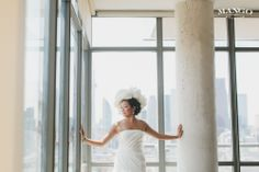I Spy..  A Glorious Bride ! #bride #building #weddings #white #flowers #dress #veil  #glowing #ideas #weddinginspiration #mangostudios Photography by Mango Studios