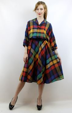 The item: Vintage eighties RAINBOW PLAID MIDI DRESS. Buttons up bust. Elastic waist. Accessories are not included. We just love, love, love this dress &