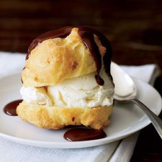 To save 365 calories and 29 grams of fat per serving, we cut the butter in the puffs by 2 tablespoons, made 10 puffs instead of our usual 8, and used light ice cream and a drizzle of chocolate sauce.