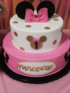 Pink, black , and gold minnie mouse cake