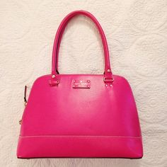Kate Spade Neon Pink Handbag Not sure which style this is because they seem to don't have it anymore, but it looks like an older version of the Wellesley Medium Rachelle. It's in EXCELLENT condition and comes with the care booklet. kate spade Bags Totes