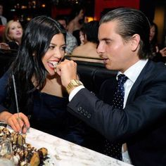 """Kourtney Kardashian isn't afraid to indulge. She told SHAPE she not only loves burgers and Mexican food, she also loves to snack on cookies and chips. """"Lately I have been having healthier snacks. There are these all-organic cheese puffs that are so good."""" Kourtney is seen here with Scott Disick enjoying a not-so-healthy birthday splurge on April 15, 2011 in Las Vegas."""
