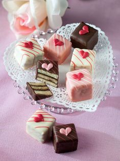 Petit Fours: Sweep your true love off his or her feet with these delectable multi-later petit fours. Each tempting valentine treat consists of rich almond butter cake layered with chocolate truffle, chocolate cherry, raspberry, or strawberry filling and then enrobed in creamy chocolate.