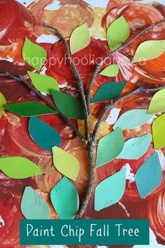 Paint Chip Apple Tree.  Terrific art activity for preschoolers!  Kids can explore the colours of fall, and the texture of real tree bark with this creative project! - Happy Hooligans