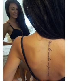 """spine tattoo..love the writing """"none but ourselves can free our mind."""""""