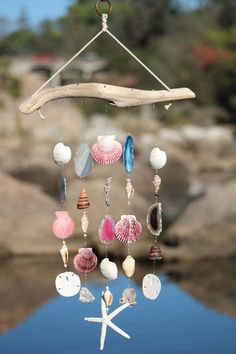 Brown Chula Chimes.  This one of a kind wind chime is made with naturally sea-worn driftwood collected from the pacific northwest and showcases five geo agate slabs and three agate druzy rocks. Who wouldn't want to have one of these beautiful wind chimes hanging on their patio.  Shop Now!!  https://www.etsy.com/listing/268799063/handmade-driftwood-seashell-wind-chimes?ref=pr_shop