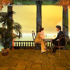 Romantic painting with a couple relaxing with a glass of wine while watching the sunset