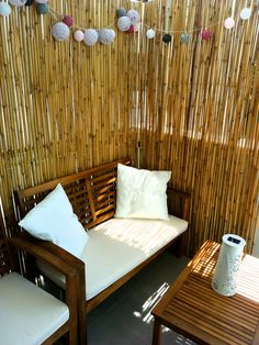 Bamboo sticks are a great idea to create intimacy on an open balcony and make it cozy