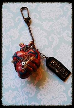 """Steampunk heart keychain made of polymer clay, gears, and wire. Tag says """"Fragile handle with care""""  https://www.etsy.com/listing/125073658/fragile-handle-with-care-steampunk-heart"""