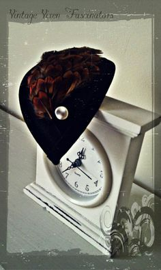 'Elizabeth Woodville' fascinator... Black felt teardrop base with velvet trim. This has been layered with a complimenting shape of tan and black pheasant feathers which have a beautiful pinky/purple sheen in the light. Finished with a vintage faux-pearl button.  Inspired by the beautiful portait of Elizabeth Woodville, Queen consort of England.  £22.50 Elizabeth Woodville, Pheasant Feathers, Black Felt, Fascinators, Vixen, Vintage Inspired, England, Clock, Pearl