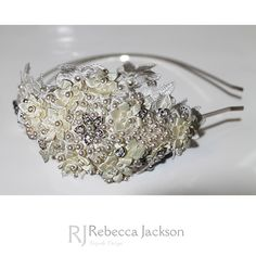 Rebecca Jackson 'Maisie' Bespoke Bridal Tiara.       Ivory Swarovski Pearls are hand beaded with beautiful crystals and diamantes, with small Ivory satin flowers hand sewn with Ivory Swarovski Pearls sewn to the centre of each. Larger ivory satin flowers are sewn in a beautiful design on