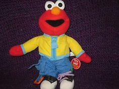 Elmo,learn to dress elmo Sesame Street fisher price plush, stuffed singing doll