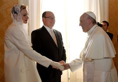 VATICAN CITY (AP) — Princess Charlene has charmed Pope Francis during a private call on the pontiff at the Vatican alongside her husband, Prince Albert II of Monaco.