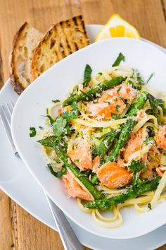 Smoked salmon pasta with asparagus & parmesan. Made with mushrooms, onions, and spinach instead of asparagus.